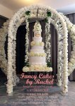 floral arch with swing wedding cake